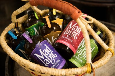 Mad Magic kombucha in a market basket at Great Country Farms