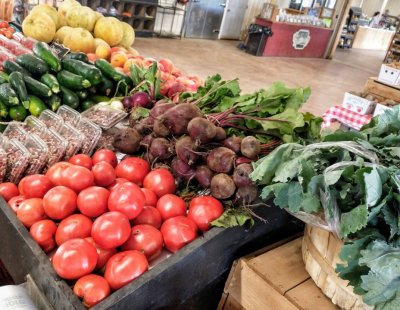 Fresh tomatoes, beets, zucchini and cantaloupe grace the shelves in the Farm Market at Great Country Farms