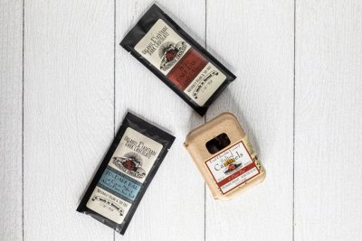3 different bars of Farmhouse Chocolates on display on a white background in the farm market at Great Country Farms